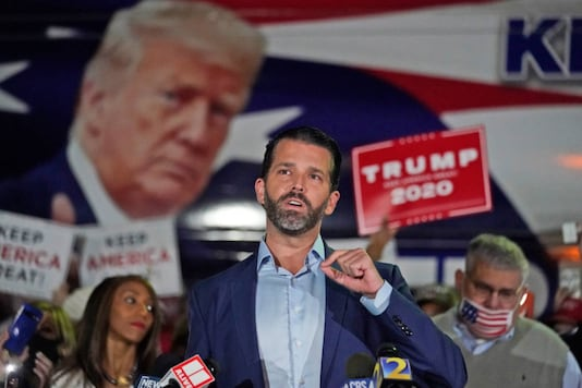 Donald Trump Jr., gestures as he speaks during a news conference at Georgia Republican Party headquarters Thursday, Nov. 5, 2020 in Atlanta. (AP Photo/John Bazemore)