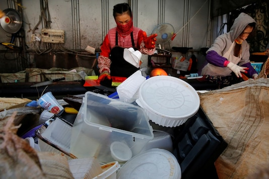 Workers separate different types of plastic at a recycling center in Goyang, South Korea.(REUTERS/Heo Ran)