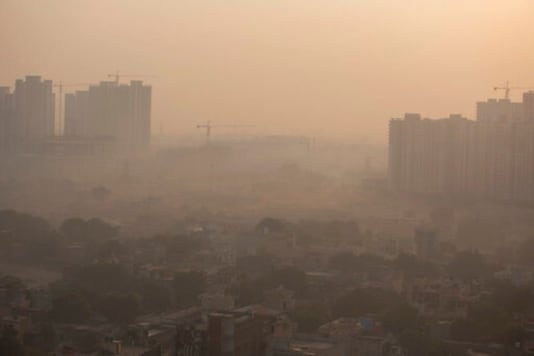 Morning haze envelops the skyline on the outskirts of New Delhi, India, Friday, Oct. 16, 2020. The Indian capitals air quality levels plunged to very poor on Friday, days after the state government initiated stricter measures to fight chronic air pollution. (AP Photo/Altaf Qadri)