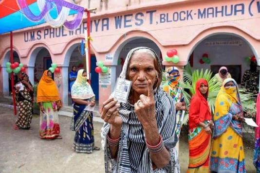 A woman casts her vote during the Bihar elections