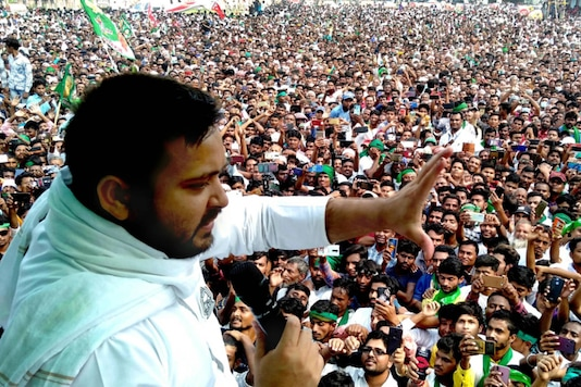 RJD leader Tejashwi Yadav addresses an election rally in Madhubani district on November 3, 2020. (PTI Photo)