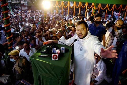 RJD leader Tejashwi Yadav addresses supporters during an election campaign at Bidupur Raghopur in Vaishali district of Bihar on October 31, 2020. (PTI Photo)