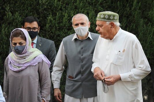 Members of People's Alliance for Gupkar Declaration Farooq Abdullah, Mehbooba Mufti, Omar Abdullah and others during a press conference after their meeting, at Bathindi in Jammu, Saturday. (PTI)