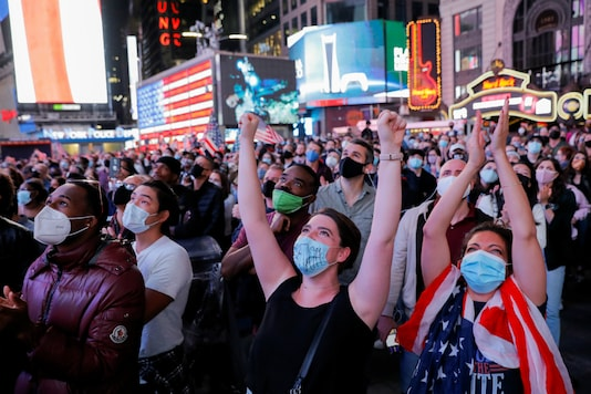 People react as they watch a speech by Democratic 2020 U.S. presidential nominee Joe Biden after news media announced that he has won the 2020 U.S. presidential election, on Times Square in New York City, U.S. November 7, 2020. Reuters/Andrew Kelly