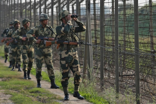 File photo of Border Security Force (BSF) soldiers patrolling along the fenced border with Pakistan near Jammu. (REUTERS/Mukesh Gupta)