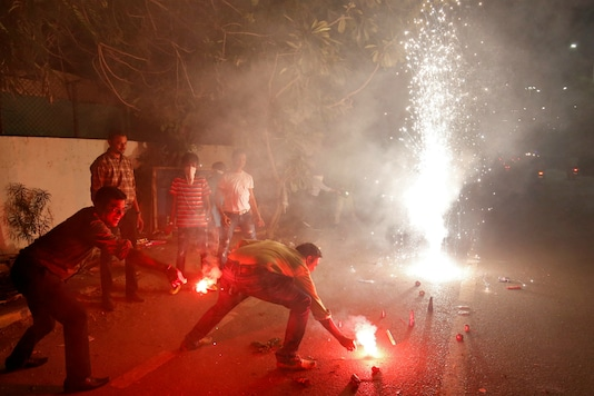 People burst firecrackers to celebrate Diwali. (Reuters file)