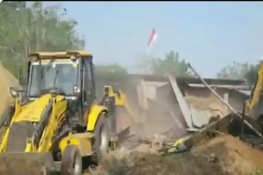 Authorities demolishing encroachments belonging to Computer Baba in Super Corridor area of Indore. (Image: ANI)