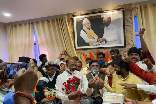 BJP Telangana president Bandi Sanjay greeted by party activists on leads in Dubbak by-election. (News18)