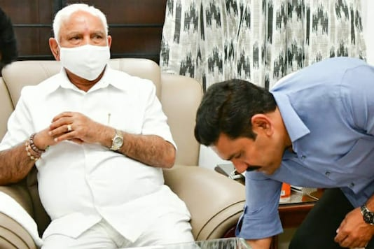 BY Vijayendra seeks his father and chief minister BS Yediyurappa's blessings after delivering a win for the BJP in the tough Sira assembly seat.