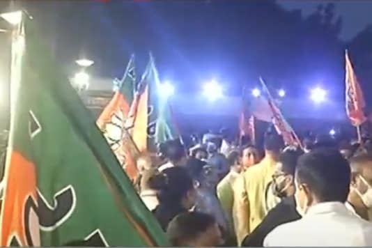 BJP workers celebrate at party headquarters in New Delhi on Tuesday