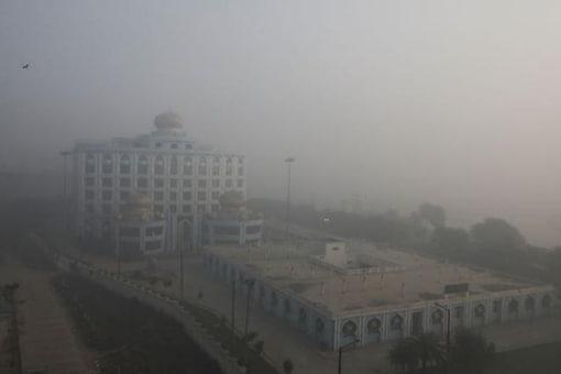 Buildings are seen shrouded in smog in Ghaziabad, India, November 10, 2020.Credit: REUTERS/ Anushree Fadnavis