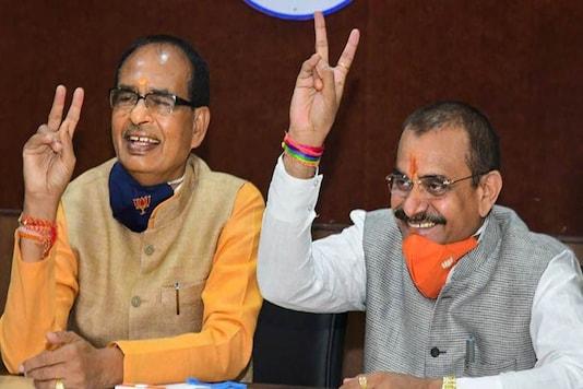Madhya Pradesh CM Shivraj Singh Chouhan along with state BJP president VD Sharma (PTI)