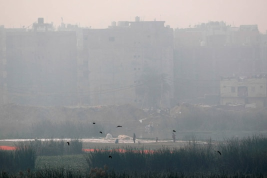 High-rises seen through a thick cover of smog near the banks of the Yamuna river in New Delhi on November 14, 2020. (REUTERS/Adnan Abid)