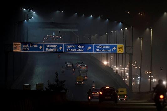 New Delhi: Vehicles ply amid low visibility due to smog during Diwali celebrations, in New Delhi, Saturday, Nov. 14, 2020. (PTI Photo/Kamal Singh)