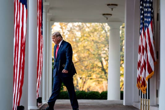 President Donald Trump walks to the Rose Garden of the White House in Washington, Nov. 13, 2020. (Anna Moneymaker/The New York Times)