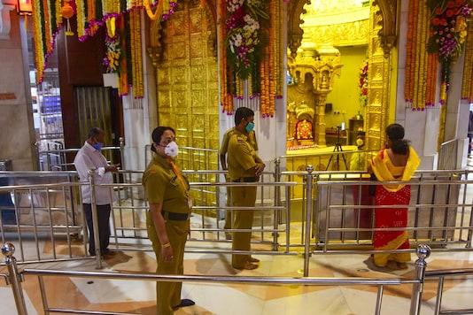 Mumbai: Devotee offer prayers at Siddhivinayak temple after it was reopened public, in Mumbai, Monday, Nov 16, 2020. (PTI Photo)