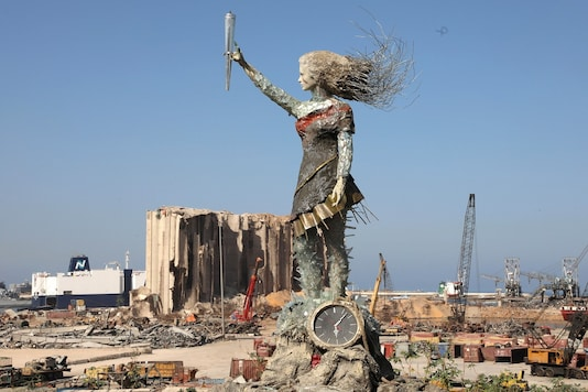 A view shows a statue by Lebanese artist, Hayat Nazer, which is made entirely out of broken glass and debris of the August 4 port explosion, near the port of Beirut, Lebanon. (REUTERS/Mohamed Azakir)