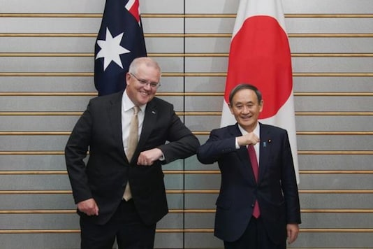 Australian Prime Minister Scott Morrison, left, poses with Japan's Prime Minister Yoshihide Suga at the start of their meeting at Suga's official residence in Tokyo, Japan November 17, 2020. Eugene Hoshiko/Pool via REUTERS