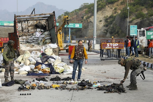 Security personnel inspect the site of encounter at Nagrota Ban toll plaza in Jammu on Thursday. (PTI Photo)