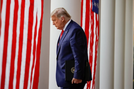 """File photo: US President Donald Trump walks down the West Wing colonnade from the Oval Office to the Rose Garden to deliver an update on the so-called """"Operation Warp Speed"""" program, at the White House in Washington, on November 13, 2020. (REUTERS/Carlos Barria/File Photo)"""
