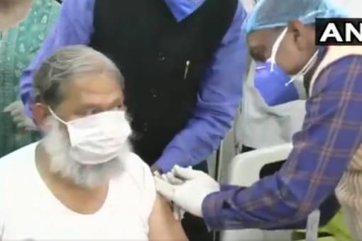 Haryana Health Minister Anil Vij is administered a trial dose of Bharat Biotech's Covid-19 vaccine candidate Covaxin at the Civil Hospital at Ambala Cantt on Friday. (Twitter/@ANI)