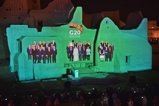 A family photo of G20 Leaders is projected at the historic site of al-Tarif in Diriyah district, on the outskirts of Saudi capital Riyadh, ahead of G20 virtual summit on November 20, 2020. (Photo by FAYEZ NURELDINE / AFP)
