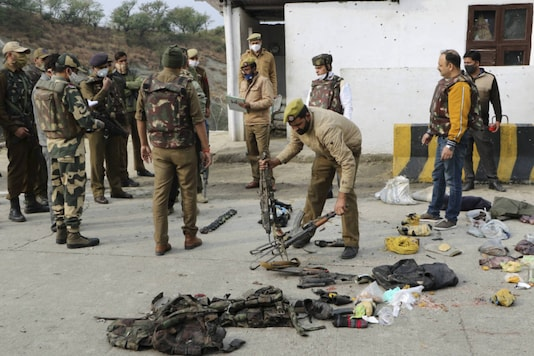Security personnel inspect the site of encounter at Nagrota Ban toll plaza in Jammu, on November 19, 2020. (PTI)
