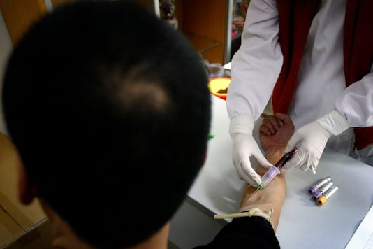 For representation: A man has a sample of blood taken by a nurse for testing at the HIV/AIDS ward of a Beijing hospital. (Reuters)