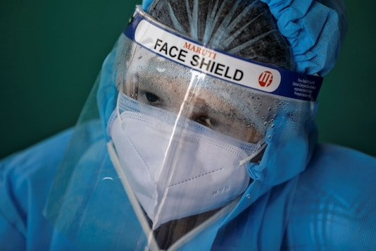 healthcare worker wearing personal protective equipment (PPE) is seen during a testing campaign for the coronavirus disease (COVID-19) in Ahmedabad, India November 24, 2020. REUTERS/Amit Dave