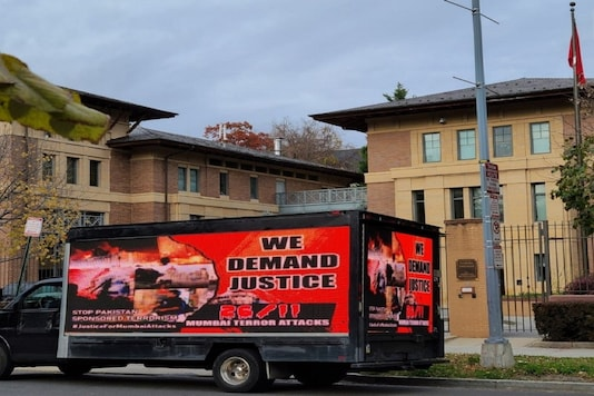 A truck with a billboard, reading