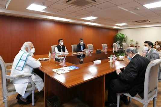 PM Narendra Modi chairs a meeting during his visit to Serum Institute of India in Pune. (AFP)
