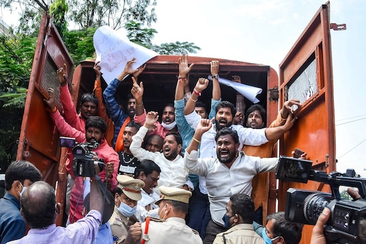 Hyderabad: Police detain Telangana BJP leaders and party workers during a protest, in front of the State Election Commissioner office in Hyderabad, Monday. (PTI Photo)