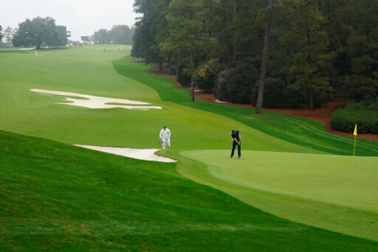 The Latest: The Masters Stopped By Rain Soon After It Begins