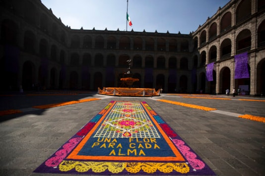 A patio inside the presidential palace is decorated with the traditional colors of Day of The Dead, with the Spanish message