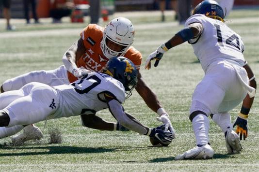 No. 22 Texas' Defense Holds Off West Virginia, 17-13