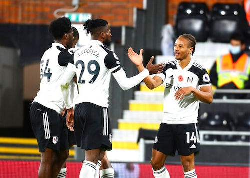 Fulham's Bobby Decordova-Reid, right, celebrates after scoring his side's opening goal during the English Premier League soccer match between Fulham and West Bromwich Albion at Craven Cottage in London, England, Monday, Nov. 2, 2020. (Clive Rose/Pool via AP)