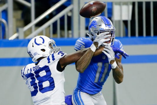Indianapolis Colts cornerback T.J. Carrie (38) deflects a pass intended for Detroit Lions wide receiver Marvin Jones (11) during the second half of an NFL football game, Sunday, Nov. 1, 2020, in Detroit. (AP Photo/Duane Burleson)
