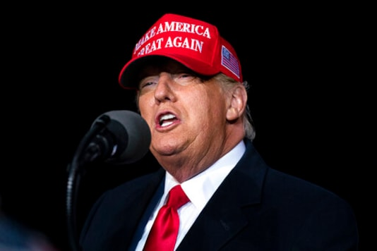 President Donald Trump speaks during a campaign rally at Richard B. Russell Airport, Sunday, Nov. 1, 2020, in Rome, Ga. (AP Photo/Evan Vucci)