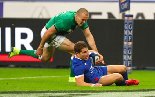 France's Antoine Dupont runs over the line, as Ireland's Jacob Stockdale attempts to stop, to score the first try of the game during the Six Nations rugby union international match between France and Ireland in Paris, France, Saturday, Oct. 31, 2020. (AP Photo/Thibault Camus)