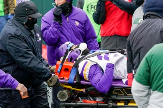 Minnesota Vikings' Cameron Dantzler is taken off the field after being injured during the first half of an NFL football game against the Green Bay Packers Sunday, Nov. 1, 2020, in Green Bay, Wis. (AP Photo/Morry Gash)