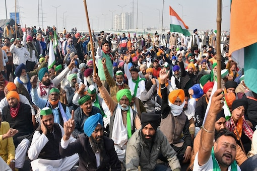 Farmers raise slogans during their 'Delhi Chalo' protest march against the new farm law, at Ghazipur in New Delhi on Thursday, December 3, 2020.  (PTI Photo)