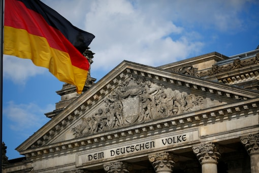 A German flag flutters in front of the Reichstag building in Berlin, Germany, September 6, 2020. (REUTERS/Joachim Herrmann)