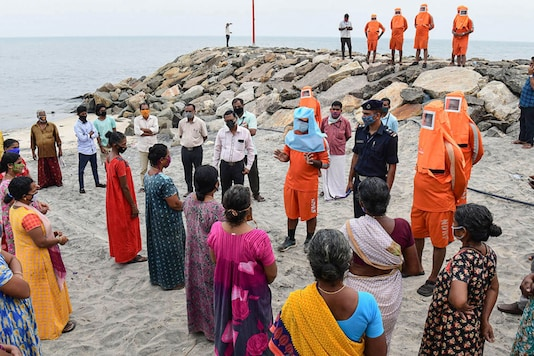 National Disaster Response Force personnel raise awareness among the residents living near Karur Ayyankovikal coast ahead of the landfall of Cyclone Burevi, in Alappuzha district on December 3, 2020. (PTI Photo)