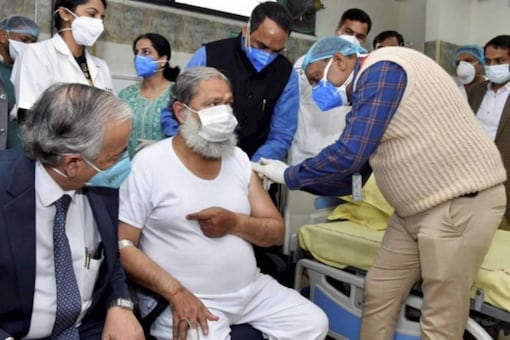 File photo of Haryana health minister Anil Vij being administered a dose of Covaxin.