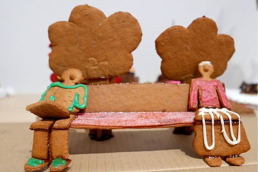 Two gingerbread figures sitting apart on a bench to illustrate social distancing are seen during the annual gingerbread baking competition at Arkdes Museum of Architecture and Design in Stockholm, Sweden December 7, 2020. REUTERS/Philip O'Connor