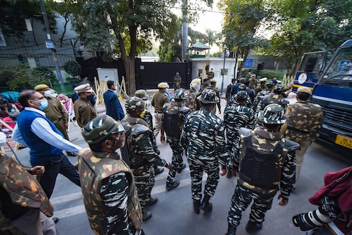 Security personnel stand outside the residence of Delhi CM and AAP leader Arvind Kejriwal, in New Delhi, Tuesday. (PTI)