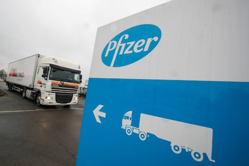 A refrigerated truck leaves the Pfizer plant in Puurs, Belgium on December 3, 2020. (REUTERS/Yves Herman)