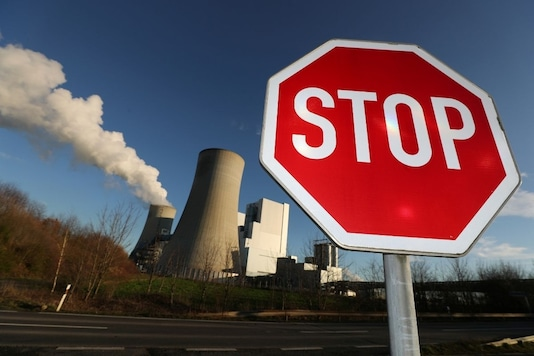 For representation: A Stop sign stands in front of the Neurath lignite power plant of German utility RWE, west of Cologne, Germany, January 16, 2020. REUTERS/Wolfgang Rattay