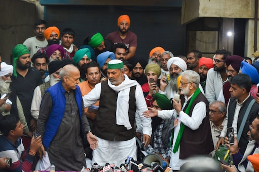 Farmer leader Shiv Kumar Kakkaji, Bharatiya Kisan Union spokesperson Rakesh Tikiat and other farmer leaders address the media after their meeting on the Centre's new farm laws proposal, near Singhu border on December 9, 2020. (PTI Photo/Manvender Vashist)