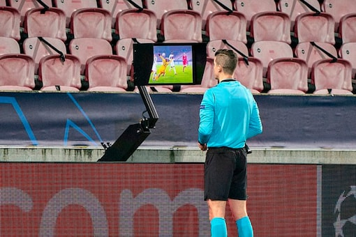 A VAR check during the UEFA Champions League match between Midtjylland and Liverpool (Image: AFP via Getty Images)